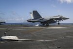 In this Monday, May 20, 2019 photo, an F/A-18E Super Hornet from the ìFist of the Fleetî of Strike Fighter Squadron (VFA) 25 lands on the flight deck of the Nimitz-class aircraft carrier USS Abraham Lincoln in the Arabian Sea. (Mass Communication Specialist 3rd Class Jeff Sherman/U.S. Navy via AP)