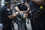 Police detain a protester during a solidarity rally for George Floyd, Saturday, May 30, 2020, in New York. Demonstrators took to the streets of New York City to protest the death of Floyd, a black man who was killed in police custody in Minneapolis on May 25. (AP Photo/Wong Maye-E)