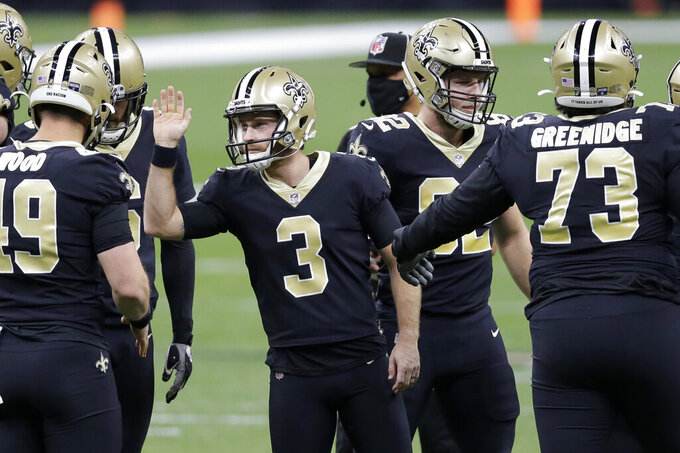 New Orleans Saints kicker Wil Lutz (3) celebrates with teammates after kicking a field goal against the Tampa Bay Buccaneers during the first half of an NFL divisional round playoff football game, Sunday, Jan. 17, 2021, in New Orleans. (AP Photo/Brett Duke)