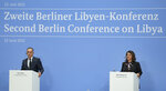 German Foreign Minister Heiko Maas, left, and Libyan Foreign Minister Najla Mangoush address the media during a joint press conferences part of the 'Second Berlin Conference on Libya' at the foreign office in Berlin, Germany, Wednesday, June 23, 2021. (AP Photo/Michael Sohn, pool)