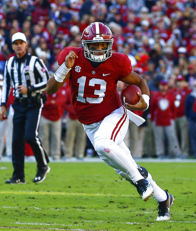 "FILE - In this Nov. 10, 2018, file photo, Alabama quarterback Tua Tagovailoa (13) scrambles for yardage during the first half of an NCAA college football game against Mississippi State, in Tuscaloosa, Ala. Tagovailoa is optimistic that he will be fully recovered from ankle surgery and ready to play in the Orange Bowl. The Alabama quarterback and Heisman Trophy runner-up said his left ankle will be just fine for the College Football Playoff semifinal game with Oklahoma on Dec. 29. ""I'll probably be at 100 percent by the time the game comes,"" Tagovailoa said Wednesday, Dec. 19, 2018. ""That's my prediction. Definitely.""  (AP Photo/Butch Dill, File)"