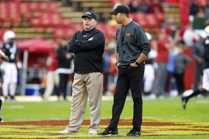 """FILE - In this Oct. 5, 2019, file photo, TCU head coach Gary Patterson, left, talks with Iowa State head coach Matt Campbell before an NCAA college football game in Ames, Iowa. """"One advantage a TCU team has is Gary Patterson has been there for 20 years and there is real continuity to the defensive staff, and great continuity on the offense staff,"""" Iowa State coach Matt Campbell said. TCU and Iowa State play on Saturday, Sept. 26. (AP Photo/Charlie Neibergall, File)"""