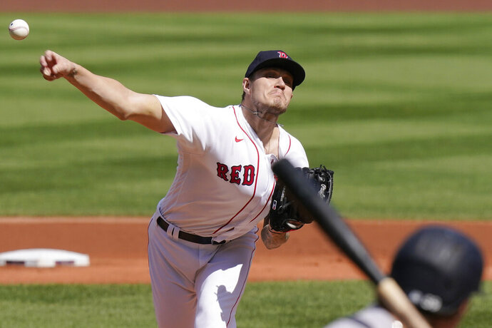 Boston Red Sox's Tanner Houck delivers a pitch against the New York Yankees in the first inning of a baseball game, Sunday, Sept. 20, 2020, in Boston. (AP Photo/Steven Senne)