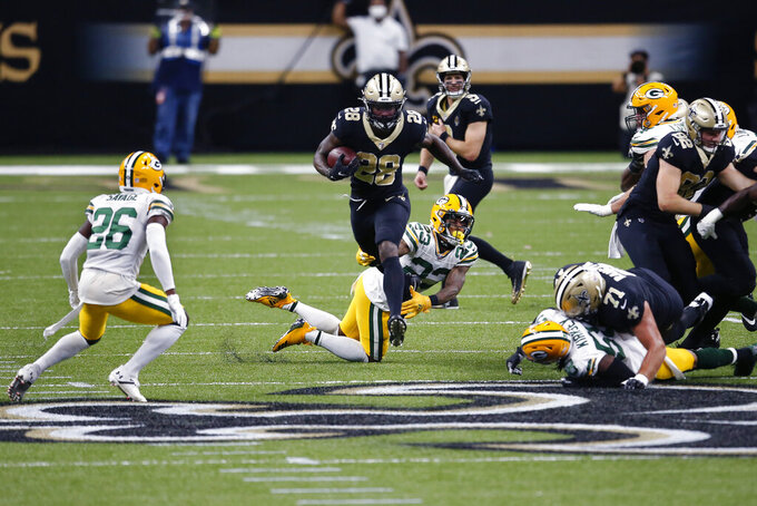 New Orleans Saints running back Latavius Murray (28) carries between Green Bay Packers cornerback Jaire Alexander (23), free safety Darnell Savage (26) and inside linebacker Christian Kirksey (58) in the first half of an NFL football game in New Orleans, Sunday, Sept. 27, 2020. (AP Photo/Butch Dill)