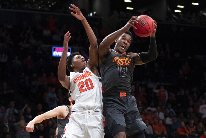 Syracuse forward Robert Braswell (20) and Oklahoma State forward Cameron McGriff (12) vies for a rebound during the second half of an NCAA college semi final basketball game in the NIT Season Tip-Off tournament, Wednesday, Nov. 27, 2019, in New York. Oklahoma State won 86-72. (AP Photo/Mary Altaffer)