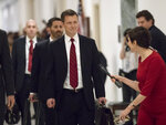 """FILE - In this June 27, 2018, file photo, Peter Strzok, the FBI agent facing criticism following a series of anti-Trump text messages, walks to gives a deposition before the House Judiciary Committee on Capitol Hill in Washington. Strzok, whose anti-Trump text messages fueled suspicions of partisan bias will tell lawmakers July 12 that his law enforcement work has never been tainted by political considerations and that the intense congressional scrutiny of him represents """"just another victory notch in Putin's belt,"""" according to prepared remarks obtained by The Associated Press.(AP Photo/J. Scott Applewhite, File)"""