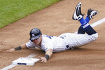 New York Yankees' Mike Tauchman advances to third on a missed pick-off attempt at first by New York Mets starting pitcher Robert Gsellman in the fourth inning of a baseball game, Saturday, Aug. 29, 2020, in New York. (AP Photo/John Minchillo)