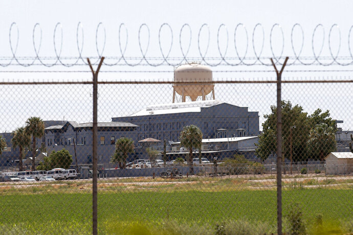 FILE - This July 23, 2014, file photo shows a state prison in Florence, Arizona. Advocates for overhauling Arizona's criminal justice system want to put a proposal on the November ballot that would cut the sentences of non-dangerous offenders for good behavior. A ballot proposal filed on Tuesday, Feb. 18, 2020, would allow for the release of non-dangerous offenders after serving 50 percent of their sentences. Currently, inmates generally must serve 85 percent of their punishments. (AP Photo/File)