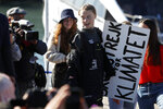 Climate activist Greta Thunberg holds a sign reading 'School strike for the climate' after arriving in Lisbon aboard the sailboat La Vagabonde Tuesday, Dec 3, 2019. Thunberg has arrived by catamaran in the port of Lisbon after a three-week voyage across the Atlantic Ocean from the United States. The Swedish teen sailed to the Portuguese capital before heading to neighboring Spain to attend the U.N. Climate Change Conference taking place in Madrid. (AP Photo/Armando Franca)