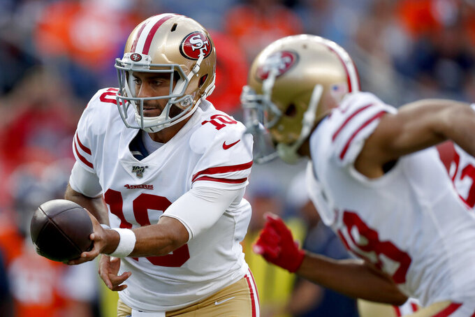 San Francisco 49ers quarterback Jimmy Garoppolo (10) looks to hand off against the Denver Broncos during an NFL preseason football game, Monday, Aug. 19, 2019, in Denver. (AP Photo/David Zalubowski)