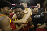 Southern California guard Jonah Mathews, center, is hugged by teammates after making a game-winning 3-point basket at the end of an NCAA college basketball game against UCLA Saturday, March 7, 2020, in Los Angeles. (AP Photo/Marcio Jose Sanchez)d