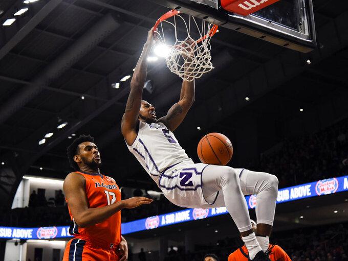 Northwestern center Dererk Pardon (5) dunks past Illinois center Adonis De La Rosa (12) during the first half of an NCAA college basketball game on Sunday, Jan. 6, 2019, in Evanston, Ill. (AP Photo/Matt Marton)