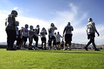 The Las Vegas Raiders offensive line runs drills during an NFL football practice Saturday, July 31, 2021, in Henderson, Nev. (AP Photo/David Becker)