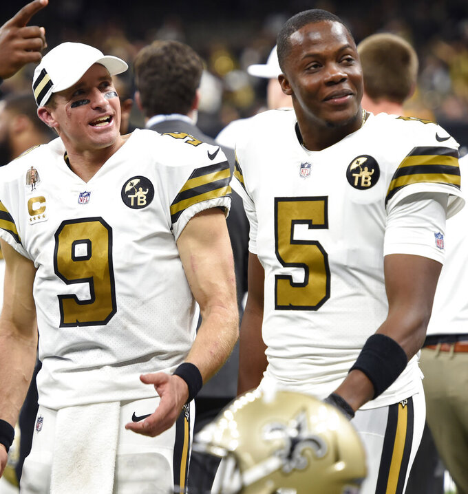 FILE - In this Nov. 18, 2018, file photo, New Orleans Saints quarterbacks Drew Brees and Teddy Bridgewater (5) chat on the sideline in the second half of an NFL football game against the Philadelphia Eagles in New Orleans. The Saints have agreed to terms on a deal Friday, March 15, 2019, with free agent quarterback Teddy Bridgewater to keep him as Drew Brees' main backup. (AP Photo/Bill Feig, File)