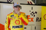 NASCAR driver Joey Logano walks out of his garage after he qualified for the NASCAR Brickyard 400 auto race at the Indianapolis Motor Speedway, Sunday, Sept. 8, 2019 in Indianapolis. (AP Photo/Darron Cummings)