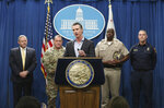 California Gov. Gavin Newsom, center, discusses his decision to withdraw several hundred National Guard troops from the nation's southern border and changing their mission, during a Capitol news conference Monday, Feb. 11, 2019, in Sacramento, Calif. Newsom, accompanied by from left, Mark Ghilarducci, director of the California Governor's Office of Emergency Services, Maj. Gen. David Baldwin, the Adjutant General of the California Military Department, Warren Stanley, Commissioner of the California Highway Patrol, right, and Thom Porter, director of the California Department of Forestry and Fire Protection, right, said he will order the troops to leave by the end of March but will leave 100 troops to focus on drug trafficking. (AP Photo/Rich Pedroncelli)