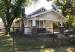 """The exterior of a home used for the 1983 film """"The Outsiders,"""" based on S.E. Hinton's classic 1967 novel, appears in Tulsa, Okla., Tuesday, Sept. 14, 2021. The home, which was purchased by rapper Danny Boy O'Connor, was converted into The Outsiders House Museum. (AP Photo/Kristi Eaton)"""