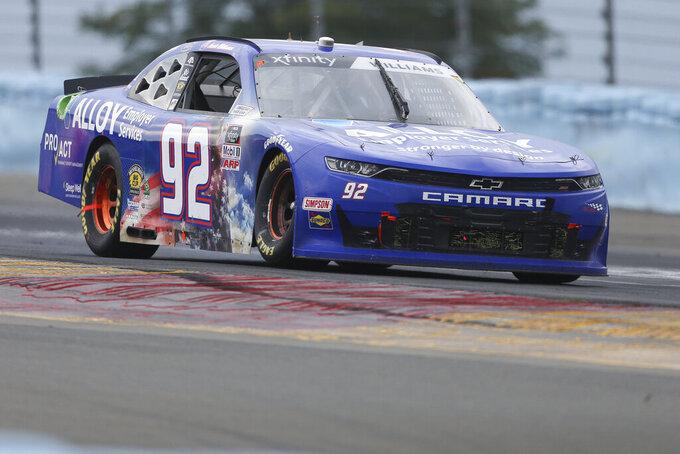 Josh Williams drives between Turn 1 and the Esses in the NASCAR Xfinity Series auto race at Watkins Glen International in Watkins Glen, N.Y., on Saturday, Aug. 7, 2021. (AP Photo/Joshua Bessex)