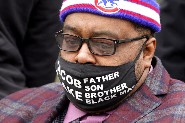 Jacob Blake Jr. listens to a speech during a Get Out The Vote (GOTV) rally in Chicago, Thursday, Oct. 29, 2020. The families of Breonna Taylor, George Floyd, Alvin Cole and Jacob Blake encouraged residents to vote. (AP Photo/Nam Y. Huh)