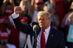 President Donald Trump pumps his fist after speaking at a campaign rally at Phoenix Goodyear Airport Wednesday, Oct. 28, 2020, in Goodyear, Ariz. (AP Photo/Ross D. Franklin)
