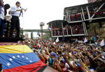 Opposition leader Juan Guaido, Venezuela's self-proclaimed interim president, speaks during a rally in Carrizal, Miranda State, Venezuela, Saturday, March 30, 2019. Guaido addressed the crowd while Nicolas Maduro loyalists gathered for what was billed as an