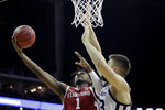 Stanford guard Daejon Davis (1) shoots under pressure from Butler forward Bryce Golden (33) during the first half of an NCAA college basketball game, Tuesday, Nov. 26, 2019, in Kansas City, Mo. (AP Photo/Charlie Riedel)