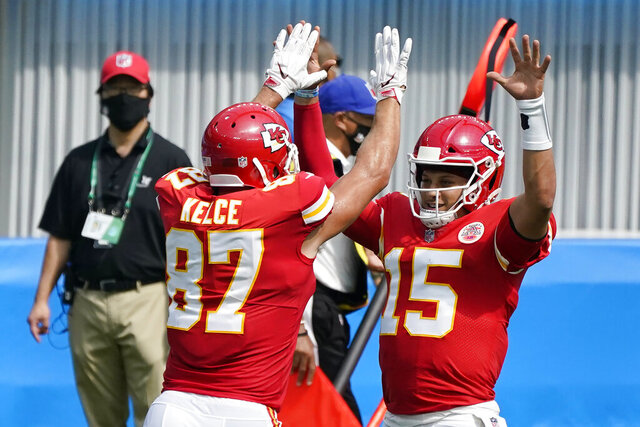Kansas City Chiefs quarterback Patrick Mahomes (15) celebrates after throwing a touchdown pass to tight end Travis Kelce (87) during the first half of an NFL football game Sunday, Sept. 20, 2020, in Inglewood, Calif. (AP Photo/Ashley Landis )