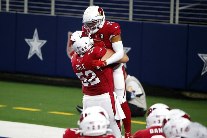 Arizona Cardinals' Mason Cole (52) and Christian Kirk (13) celebrate a touchdown scored by Kirk in the first half of an NFL football game against the Dallas Cowboys in Arlington, Texas, Monday, Oct. 19, 2020. (AP Photo/Michael Ainsworth)
