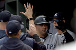 New York Yankees designated hitter Gary Sanchez (24) celebrates with teammates after hitting a home run in the third inning of a baseball game against the Baltimore Orioles, Sunday, April 7, 2019, in Baltimore. (AP Photo/Will Newton)