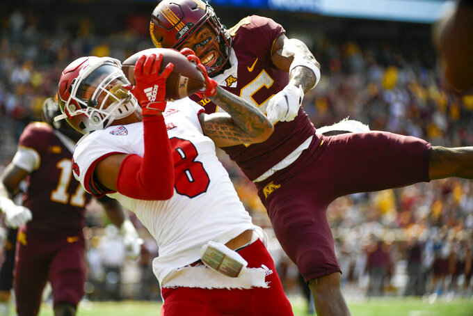 Miami-Ohio wide receiver Mac Hippenhammer (8) catches a 33-yard pass for a touchdown in front of Minnesota defensive back Coney Durr during the second half of an NCAA college football game on Saturday, Sept. 11, 2021, in Minneapolis. Minnesota won 31-26. (AP Photo/Craig Lassig)
