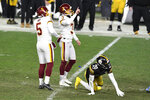 Washington Football Team kicker Dustin Hopkins (3) celebrates after kicking a 45-yard field goal during the second half of an NFL football game against the Pittsburgh Steelers, in Pittsburgh, Monday, Dec. 7, 2020. Washington won 23-17. (AP Photo/Barry Reeger)