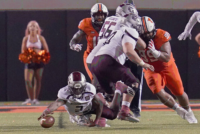 Missouri State quarterback Jason Shelley reaches for a fumble in the second half of an NCAA college football game against Oklahoma State, Saturday, Sept. 4, 2021, in Stillwater, Okla. (AP Photo/Sue Ogrocki)