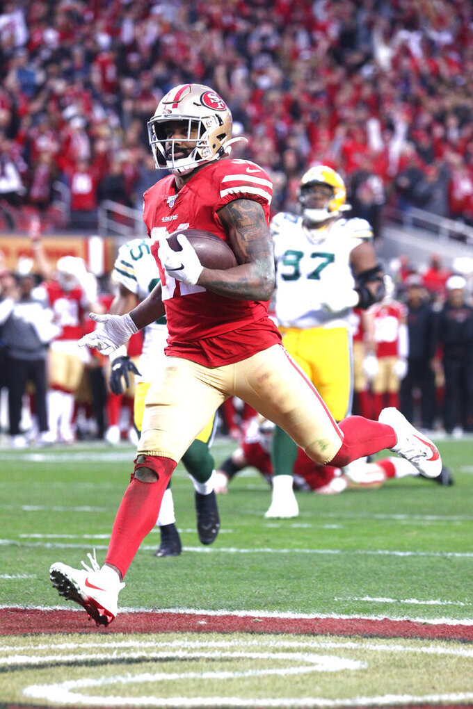 San Francisco 49ers running back Raheem Mostert (31) leaps over the goal line for a touchdown during the NFL NFC Championship football game against the Green Bay Packers, Sunday, Jan. 19, 2020 in Santa Clara, Calif. The 49ers defeated the Packers 37-20 (Margaret Bowles via AP)