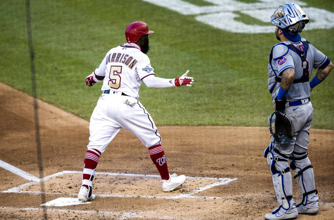 Washington Nationals' Josh Harrison (5) gestures toward the team's dugout after stepping on home with a home run during the second inning of the team's baseball game against the New York Mets in Washington, Tuesday, Aug. 4, 2020. (AP Photo/Manuel Balce Ceneta)