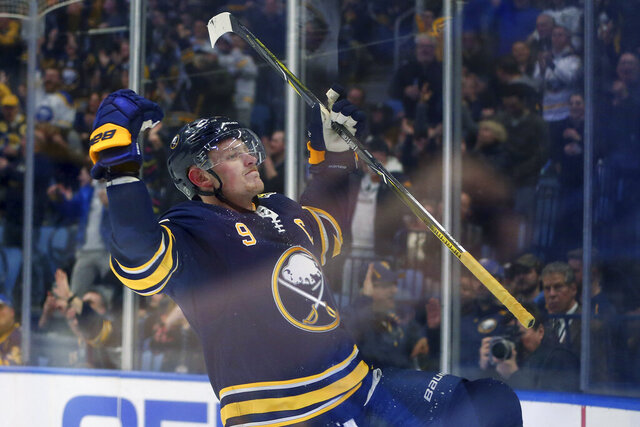 Buffalo Sabres forward Jack Eichel (9) celebrates his goal during the third period of an NHL hockey game against the Vegas Golden Knights, Tuesday, Jan. 14, 2020, in Buffalo, N.Y. (AP Photo/Jeffrey T. Barnes)