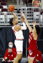 Ohio State forward Justice Sueing, left, goes up for a shot against Indiana guard Trey Galloway during the first half of an NCAA college basketball game in Columbus, Ohio, Saturday, Feb. 13, 2021. (AP Photo/Paul Vernon)