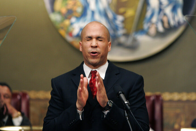 FILE - In this Feb. 8, 2007 file photo, then Newark Mayor Cory Booker gestures during his first State of the City address at City Hall in Newark, N.J. Months after Booker took office as mayor of Newark, N.J. in 2006, he enabled his law partner to take power at the nonprofit that supplied water to 500,000 state residents. During the ensuing seven years, allies of the two-term mayor wasted millions of dollars in public money at the Newark Watershed Conservation and Development Corporation. Booker says he was unaware of the corruption, which ultimately destroyed the nonprofit created to protect one of Newark's most valuable assets.  (AP Photo/Mike Derer)