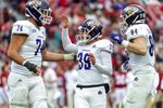 Western Carolina kicker Julian Pletz (39) celebrates his field goal with offensive lineman Tyler Smith (74) and tight end Owen Cosenke (84) during the second half of an NCAA college football game against Alabama, Saturday, Nov. 23, 2019, in Tuscaloosa, Ala. (AP Photo/Vasha Hunt)
