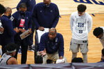 Georgetown head coach Patrick Ewing, center, talks to his players during a timeout in the first half of an NCAA college basketball game against Marquette in the Big East conference tournament Wednesday, March 10, 2021, in New York. (AP Photo/Frank Franklin II)