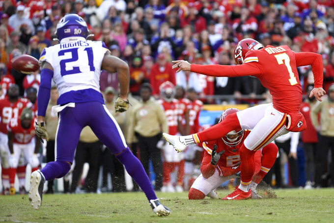 Kansas City Chiefs kicker Harrison Butker (7) boots a winning field goal as Minnesota Vikings cornerback Mike Hughes (21) watches during the second half of an NFL football game in Kansas City, Mo., Sunday, Nov. 3, 2019. (AP Photo/Reed Hoffmann)