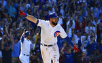 Chicago Cubs' David Bote (13) reacts after hitting a walk off single during the ninth inning of a baseball game against the Arizona Diamondbacks Sunday, April 21, 2019, in Chicago. (AP Photo/Matt Marton)