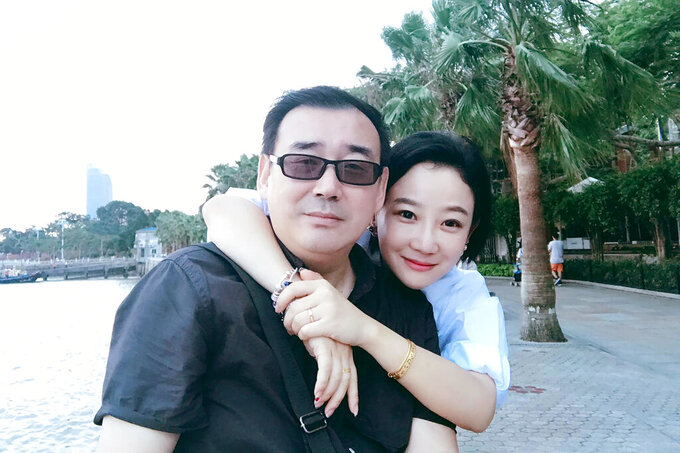 FILE - This undated, file photo released by Chongyi Feng shows Yang Hengjun and his wife Yuan Xiaoliang.  The Chinese Australian writer tried in Beijing for alleged espionage said he pleaded to a judge to reject evidence of what he had said while being tortured by interrogators. Yang faced a closed trial on Thursday. The court deferred its verdict to a later date.(Chongyi Feng via AP, File)