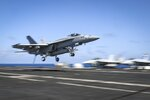 In this Monday, May 20, 2019 photo, an F/A-18E Super Hornet from the Fist of the Fleet of Strike Fighter Squadron (VFA) 25 lands on the flight deck of the Nimitz-class aircraft carrier USS Abraham Lincoln in the Arabian Sea. (Mass Communication Specialist 3rd Class Jeff Sherman/U.S. Navy via AP)