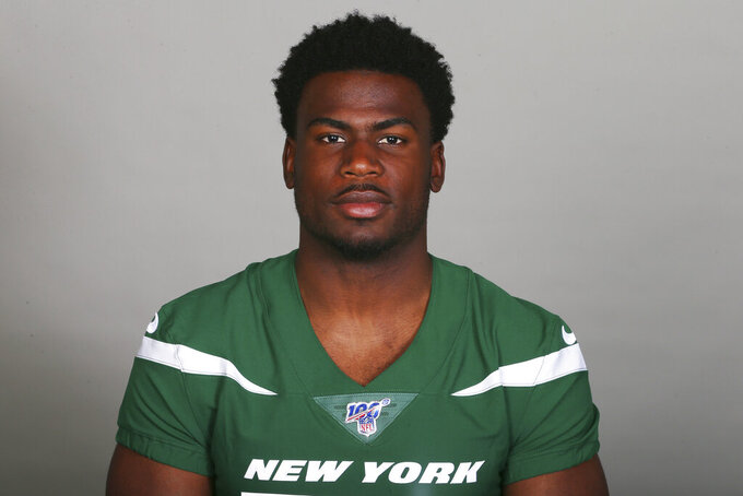 This is a 2019 file photo showing Quincy Enunwa of the New York Jets NFL football team. Jets wide receiver Quincy Enunwa will be sidelined the rest of the season with a neck injury, his second in just over two years. Coach Adam Gase says Wednesday, Sept. 11, 2019, that Enunwa is still undergoing tests to determine the severity. He also wouldn't speculate as to whether the injury could threaten Enunwa's career. (AP Photo/File)