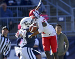 Connecticut defensive back Abiola Olaniyan (18) breaks up a pass intended for Houston wide receiver Marquez Stevenson (5) in the end zone during the first half of an NCAA college football game, Saturday, Oct. 19, 2019, in East Hartford, Conn. (AP Photo/Stephen Dunn)