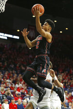 Utah guard Sedrick Barefield (2) drives past Arizona center Chase Jeter in the first half during an NCAA college basketball game, Saturday, Jan. 5, 2019, in Tucson, Ariz. (AP Photo/Rick Scuteri)