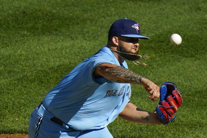 Toronto Blue Jays' Alek Manoah delivers a pitch during the second inning of the first game of a baseball doubleheader against the New York Yankees Thursday, May 27, 2021, in New York. (AP Photo/Frank Franklin II)