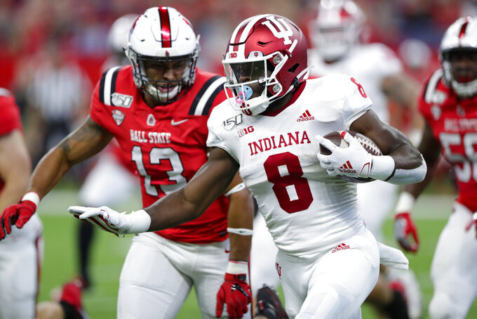 Indiana running back Stevie Scott III (8) tries to out-run Ball State linebacker Jordan Williams (13) during the first half of a college football game in Indianapolis, Saturday, Aug. 31, 2019. (AP Photo/Michael Conroy)