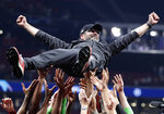Liverpool coach Juergen Klopp is thrown into the air by player after winning the Champions League final soccer match between Tottenham Hotspur and Liverpool at the Wanda Metropolitano Stadium in Madrid, Saturday, June 1, 2019. (AP Photo/Emilio Morenatti)