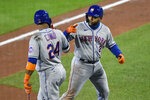 New York Mets' Dominic Smith, right, celebrates with Robinson Canó after hitting a grand slam against the Toronto Blue Jays during the fourth inning of a baseball game in Buffalo, N.Y., Friday, Sept. 11, 2020. (AP Photo/Adrian Kraus)